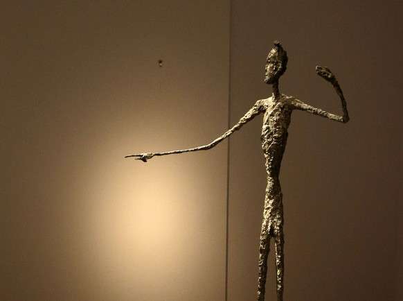 epa04743991 Alberto Giacometti's 'Pointing man', bronze with patina and handpainted by the artist is seen on display prior an auction at Christie's in New York, NY, USA, 11 May 2015. The sculpture went for a record price of 141.3 million US dollar.  EPA/JASON SZENES