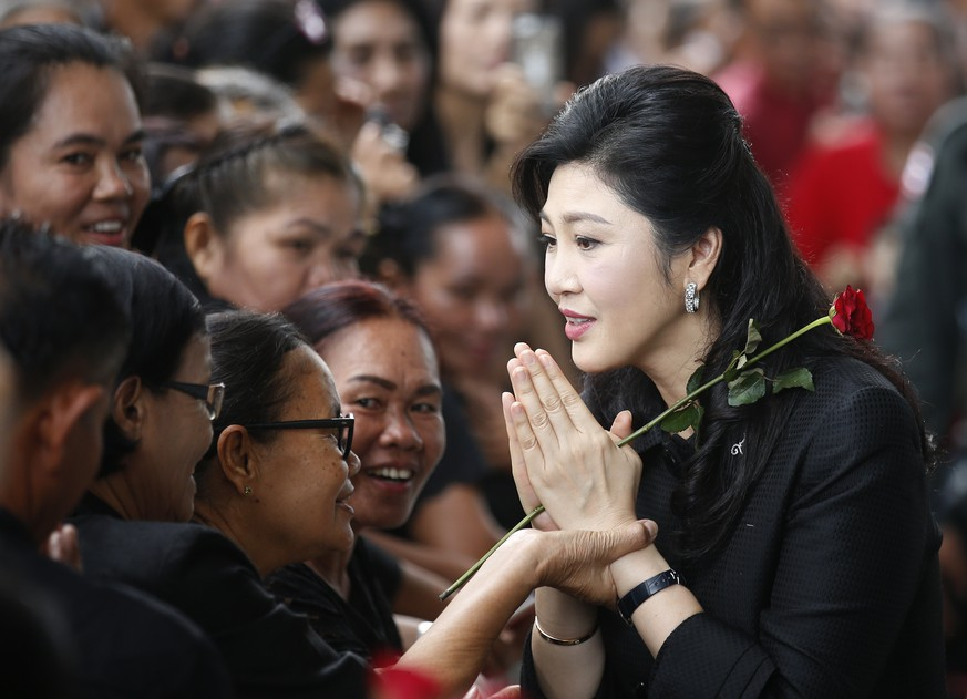 epa06161265 (FILE) - Former Thai Prime Minister Yingluck Shinawatra (R) performs the traditional Thai greeting as she arrives for her trial on criminal charges stemming from her government's rice price subsidy, at the Supreme Court's Criminal Division for Holders of Political Positions, in Bangkok, Thailand, 29 June 2017 (reissued 25 August 2017). The Thai court issued an arrest warrant for Yingluck after she failed to appear in court for her verdict and set the new verdict date for 27 September 2017. Yingluck faces a penalty from the ruling junta that she personally pays 35 billion baht (approximately 991 million US dollar) as a civil damage fine, and up to 10 years in prison if convicted on charges of criminal negligence over her government's rice pledging scheme. The rice subsidy plan was a key policy promoted during Yingluck Shinawatra's Pheu Thai party's 2011 electoral campaign.  EPA/NARONG SANGNAK