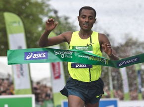 Ethiopia's runner Kenenisa Bekele crosses the finish line to win the 38th Paris Marathon,  in Paris, Sunday, April 6, 2014. Bekele completed the 42.2-kilometer race in 2 hours, 5 minutes, 3 seconds to break the race record set by Stanley Biwott of Kenya in 2012.(AP Photo/Michel Euler)