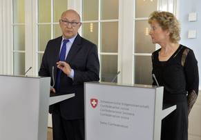 French Economy, Finance and Foreign Trade Minister Minister Michel Sapin (L) gestures next to Swiss Finance Minister Eveline Widmer-Schlumpf during a press conference following a meeting on June 25, 2014, in Bern.Sapin was attending meetings in Bern to discuss with Swiss officials several bilateral issues related to the tax system.  AFP PHOTO / Richard Juilliart