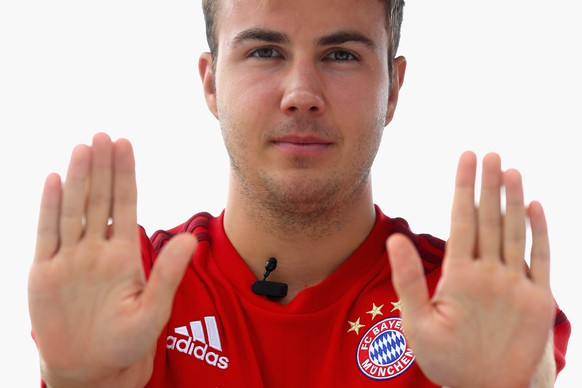 SHANGHAI, CHINA - JULY 21:  Mario Goetze of FC Bayern Muenchen performes Chinese kung-fu on the roof top of the 'Twelve at Hengshan' team Hotel on day 5 of the FC Bayern Audi China Summer Pre-Season Tour on July 21, 2015 in Shanghai, China.  (Photo by Alexander Hassenstein/Bongarts/Getty Images)