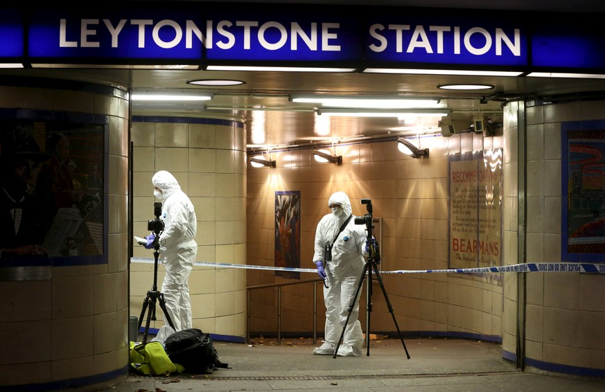 Emergency responders investigate a crime scene at Leytonstone underground station in east London, Britain December 6, 2015. Police were called to reports of a number of people stabbed at the station in east London and a man threatening other people with a knife. One man was seriously injured and two sustained minor injuries, police said. REUTERS/Neil Hall