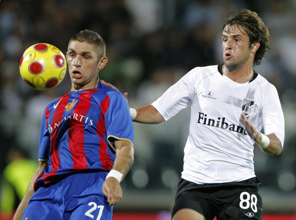 FC Basel's Francois Marque, left, vies for the ball with Vitoria Guimaraes' Jean Coral during their Champions League third qualifying round soccer match in the D. Afonso Henriques stadium in Guimaraes, Portugal, Wednesday, Aug. 13, 2008. (AP Photo/Lalo R. Villar)