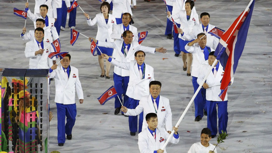 2016 Rio Olympics - Opening ceremony - Maracana - Rio de Janeiro, Brazil - 05/08/2016. Flagbearer Choe Jon Wi (PRK) of North Korea leads his contingent during the opening ceremony.  REUTERS/Stoyan Nenov FOR EDITORIAL USE ONLY. NOT FOR SALE FOR MARKETING OR ADVERTISING CAMPAIGNS.