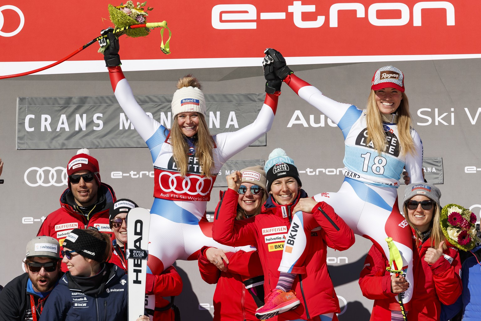 From left, Corinne Suter of Switzerland and Lara Gut-Behrami of Switzerland on the podium after the women's Downhill race of the FIS Alpine Ski World Cup season in Crans-Montana, Switzerland, Friday, February 21, 2020. (KEYSTONE/Cyril Zingaro)