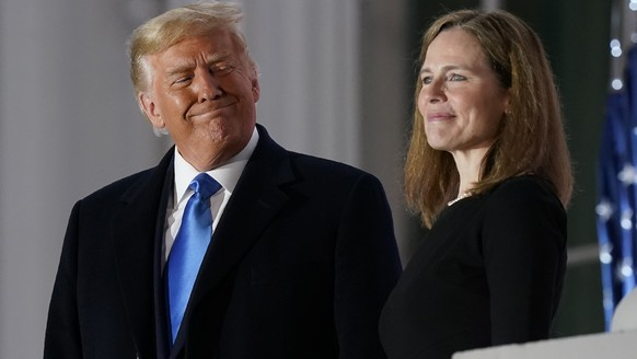 President Donald Trump and Amy Coney Barrett stand on the Blue Room Balcony after Supreme Court Justice Clarence Thomas administered the Constitutional Oath to her on the South Lawn of the White House White House in Washington, Monday, Oct. 26, 2020. Barrett was confirmed to be a Supreme Court justice by the Senate earlier in the evening. (AP Photo/Patrick Semansky)Donald Trump,Amy Coney Barrett