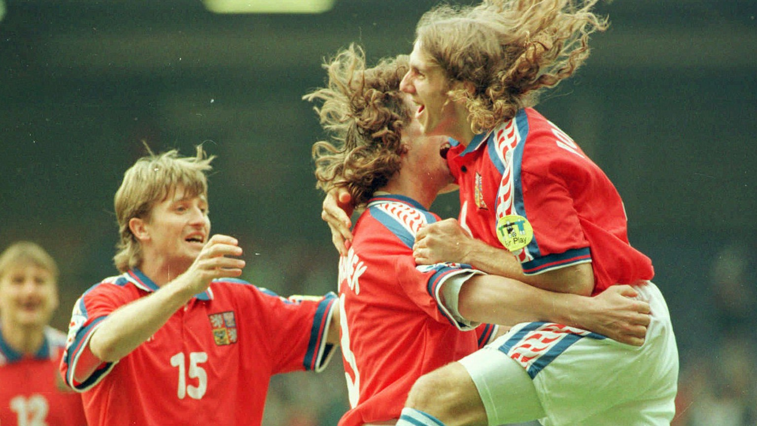 Jan Suchoparek of the Czech Republic, centre, is congratulated by Karel Poborski, right, and Michal Hornak after scoring his sides opening goal in their European Soccer Championships Group C match vs Russia at Anfield in Liverpool Wednesday June 19, 1996. (AP Photo)