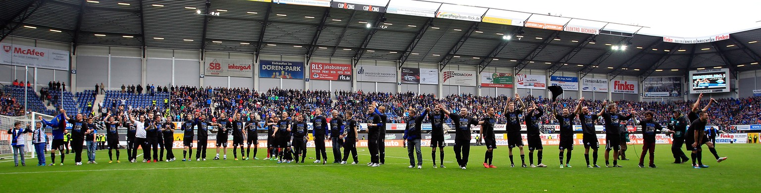 PADERBORN, GERMANY - MAY 11:  The Team of Paderborn celebrate promotion during the match between SC Paderborn and VFR Aalen at Benteler Arena on May 11, 2014 in Paderborn, Germany.  (Photo by Martin Stoever/Bongarts/Getty Images)