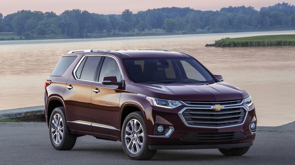 This photo provided by Chevrolet shows the 2018 Chevrolet Traverse, a three-row midsize crossover that comes standard with a V6 engine. It also offers onboard Wi-Fi, iPhone and Android phone integration, and an extensive list of active safety systems. (Jim Frenak-FPI Studios/Courtesy of Chevrolet via AP)