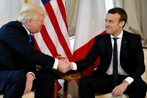 epa05989023 US President Donald J. Trump shakes hands with French President Emmanuel Macron (R) during a meeting on the sidelines of the NATO (North Atlantic Treaty Organization) summit, at the US ambassador's residence in Brussels, Belgium, 25 May 2017. Trump is in Belgium to attend a North Atlantic Treaty Organization (NATO) Summit.  EPA/PETER DEJONG/POOL MAXPPP OUT
