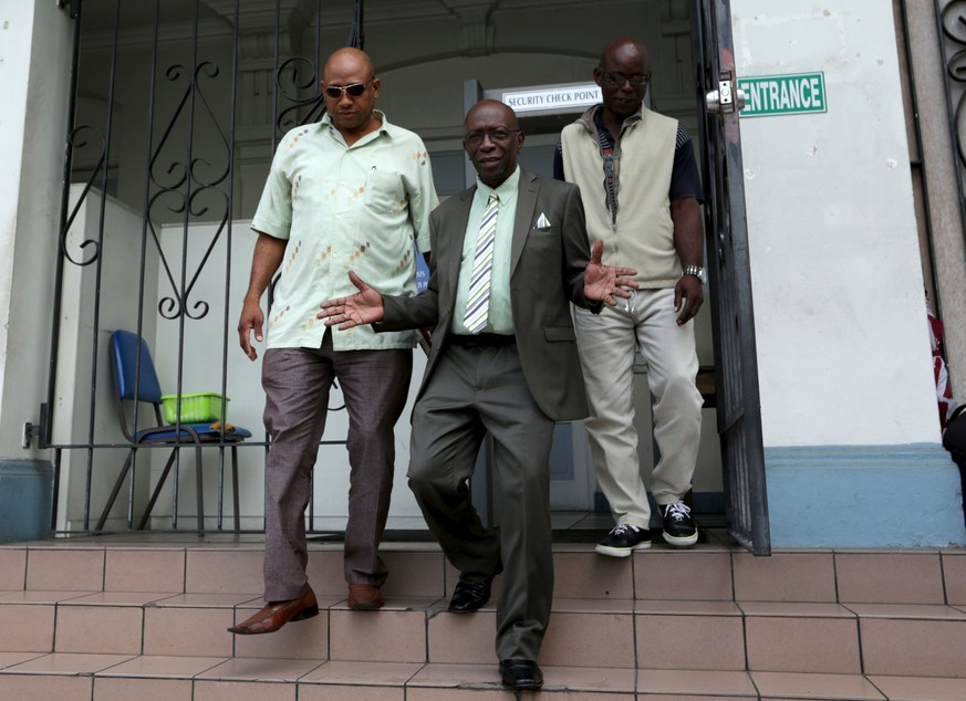 Former FIFA Vice-President Jack Warner (C) gestures while leaving the Magistrate's Court in Port-of-Spain, December 2, 2015. Warner, who is wanted in the United States on corruption charges, is fighting an extradition request. REUTERS/Andrea De Silva