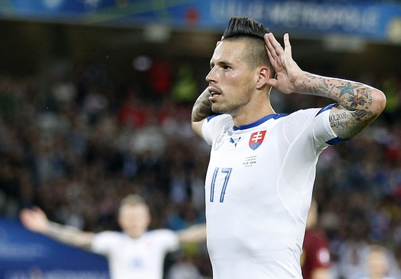 epa05366833 Marek Hamsik of Slovakia celebrates after he scored the 2-0 goal during the UEFA EURO 2016 group B preliminary round match between Russia and Slovakia at Stade Pierre Mauroy in Lille, France, 15 June 2016.  (RESTRICTIONS APPLY: For editorial news reporting purposes only. Not used for commercial or marketing purposes without prior written approval of UEFA. Images must appear as still images and must not emulate match action video footage. Photographs published in online publications (whether via the Internet or otherwise) shall have an interval of at least 20 seconds between the posting.)  EPA/LAURENT DUBRULE   EDITORIAL USE ONLY