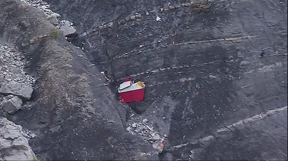 In this image made from TV, debris is scattered over the area after a Germanwings Airbus 320 crashed near Seyne-les-Alpes in the French Alps, Tuesday, March 24, 2015. A Germanwings passenger jet carrying at least 150 people crashed Tuesday in a snowy, remote section of the French Alps, sounding like an avalanche as it scattered pulverized debris across the mountain. (AP Photo / TF1, Pool)