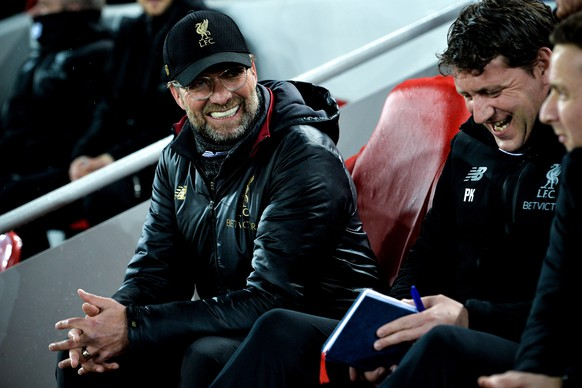 epa07381659 Liverpool's head coach Juergen Klopp (L) and assistant coach Peter Krawietz (R) react prior to the UEFA Champions League round of 16 first leg soccer match between Liverpool FC and FC Bayern Muenchen at the Anfield in Liverpool, Britain, 19 February 2019.  EPA/PETER POWELL