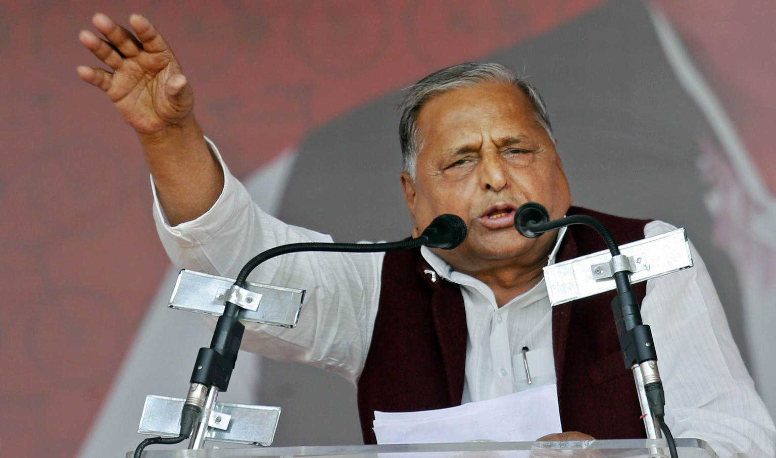 "Samajwadi Party President Mulayam Singh Yadav addresses a public rally ""Desh Banao, Desh Bachao"", or ""Make the Country, Save the Country"", in Allahabad, India, Sunday, March 2, 2014. India's biggest state, Uttar Pradesh, has 80 Loksabha, or lower parliamentary house, seats in the general elections later this year. Portrait of party leader Mulayam Singh Yadav is seen in the background. (AP Photo/Rajesh Kumar Singh)"