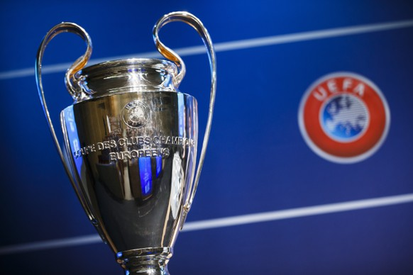 epa08301242 (FILE) - The Champions League trophy on display during the draw of the first two qualifying rounds of the UEFA Champions League 2015/16 at the UEFA Headquarters in Nyon, Switzerland, 22 June 2015 (re-issued 17 March 2020). The UEFA released on 17 March 2020 saying 'All UEFA competitions and matches (including friendlies) for clubs and national teams for both men and women have been put on hold until further notice'. The UEFA EURO 2020 has been postponed to 2021 amid the coronavirus COVID-19 pandemic.  EPA/VALENTIN FLAURAUD *** Local Caption *** 52020600