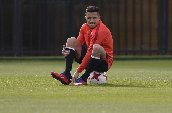 FILE - In this Saturday, June 24, 2017 file photo Chile's Alexis Sanchez attends a training session at the FC Strogino Stadium in Moscow, Russia.  Alexis Sanchez said Friday June 30, 2017  he's reached a decision on his future at Arsenal, but won't reveal it until after Sunday's Confederations Cup final. (AP Photo/Daria Isaeva, file)