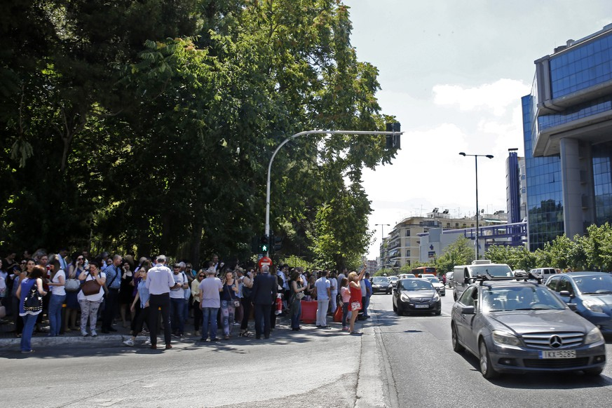 epa07726894 Citizens gather in an open area following an earthquake, in central Athens, Greece, 19 July 2019.An earthquake measuring 5.1 on the Richter scale shook Athens at 14:13 on 19 July 2019. The epicentre of the quake, according to Aristotle University of Thessaloniki professor of seismology Costas Papazachos was located in the Parnitha mountain range, above the Attica towns of Mandra and Magoula.  EPA/ALEXANDROS VLACHOS