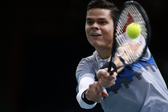Milos Raonic of Canada returns a shot against Switzerland's Roger Federer during their quarter-final match at the Paris Masters tennis tournament at the Bercy sports hall in Paris, October 31, 2014. REUTERS/Benoit Tessier (FRANCE - Tags: SPORT TENNIS)
