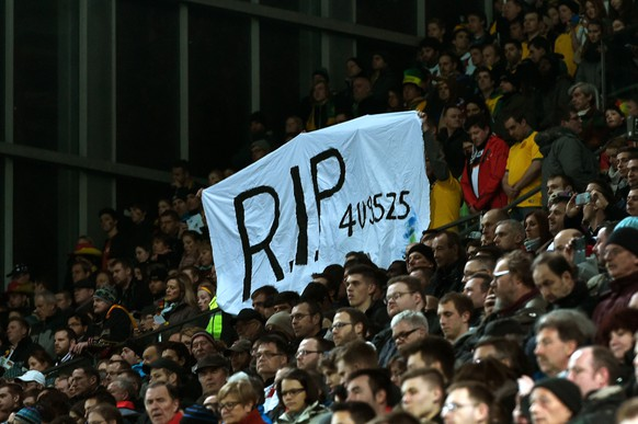 KAISERSLAUTERN, GERMANY - MARCH 25:  Fans hold up a banner in remembrance of the victims of Germanwings flight 4U9525 prior to kickoff during the International Friendly match between Germany and Australia at Fritz-Walter-Stadion on March 25, 2015 in Kaiserslautern, Germany. The Germanwings flight 4U9525 crashed in the French Alps on March 24, 2015 at Seyne, France. The Airbus A320 airliner travelling from Barcelona to Dusseldorf went down with 150 people onboard.  (Photo by Dennis Grombkowski/Bongarts/Getty Images)