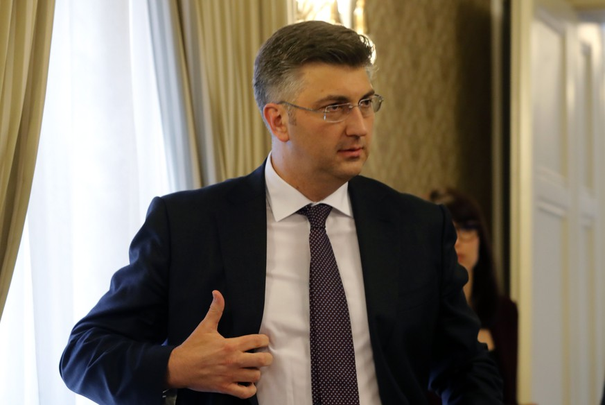 epa05930776 Croatian Prime Minister Andrej Plenkovic gestures during a press conference in Zagreb, Croatia, 27 April 2017. Reports state Plenkovic on 27 April dismissed three ministers from his coalition partner 'Most' (Bridge) party in a disagreement over the future of finance minister who the opposition are demanding his resignation.  EPA/ANTONIO BAT