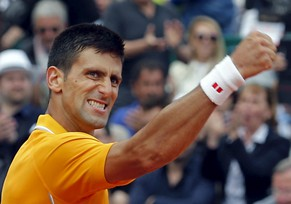 Novak Djokovic of Serbia reacts after defeating Rafael Nadal of Spain during their semi-final match at the Monte Carlo Masters in Monaco April 18, 2015. REUTERS/Jean-Paul Pelissier