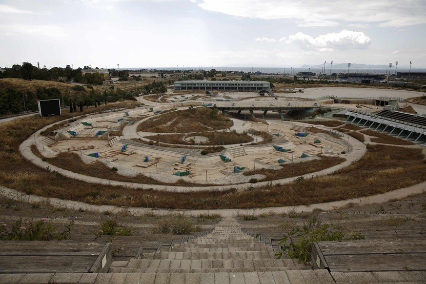 The abandoned Olympic Canoe and Kayak Slalom Centre is seen at the Hellenikon complex south of Athens July 16, 2014. Ten years after Greece hosted the world's greatest sporting extravaganza, many of its once-gleaming Olympic venues have been abandoned while others are used occasionally for non-sporting events such as conferences and weddings. For many Greeks who swelled with pride at the time, the Olympics are now a source of anger as the country struggles through a six-year depression, record unemployment, homelessness and poverty. Just days before the anniversary of the Aug. 13-29 Games in 2004, many question how Greece, among the smallest countries to ever host the Games, has benefited from the multi-billion dollar event. Picture taken July 16, 2014. REUTERS/Yorgos Karahalis (GREECE - Tags: SOCIETY SPORT POLITICS BUSINESS)
