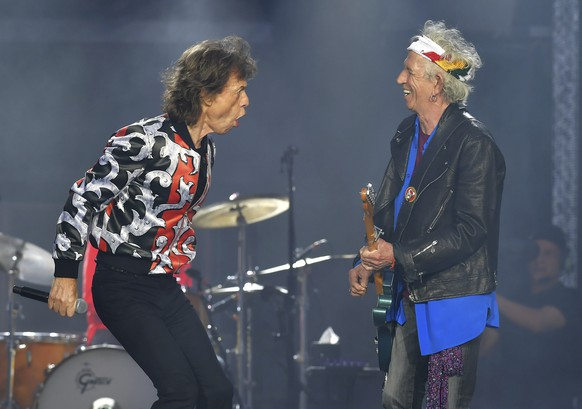 FILE - In this May 25, 2018 file photo, Mick Jagger, left, and Keith Richards, of The Rolling Stones, perform during their No Filter tour in London. The Rolling Stones will be rolling through the U.S. next year. The band says it is adding a 13-show leg to its tour in spring 2019, kicking off in Miami on April 20. (Photo by Mark Allan/Invision/AP, File)