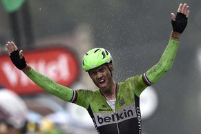 Netherland's Lars Boom celebrates as he crosses the finish line at the end of the 152,5 km fifth stage of the 101st edition of the Tour de France cycling race on July 9, 2014 between Ypres, northwestern Belgium, and Arenberg Porte du Hainaut in Wallers northern France.  AFP PHOTO / LIONEL BONAVENTURE