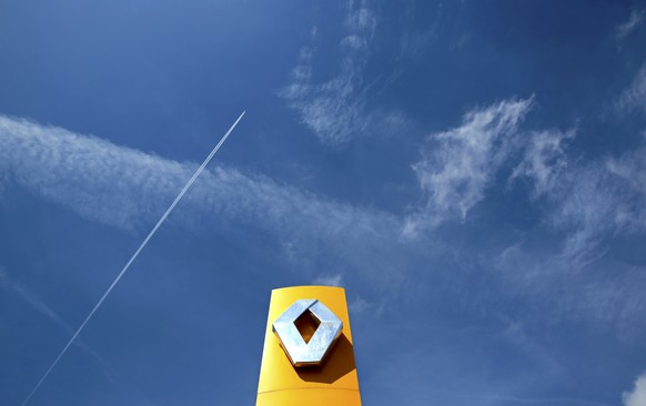 File photo shows a Renault car company logo outside an automobile dealership in Nice, France, March 29, 2016.  Renault made little progress towards promised cost savings in the first half of the year, the French carmaker said July 28, 2016, although a revamp of its model range helped it achieve record profitability.  Picture taken March 29, 2016.  REUTERS/Eric Gaillard/File photo