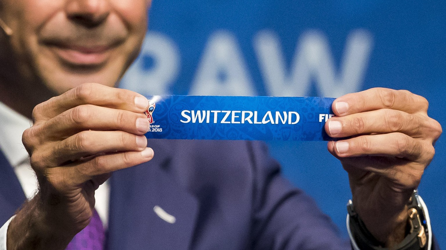 epa06271052 Spanish former soccer player Fernando Hierro shows the lot of Switzerland during the 2018 FIFA World Cup European Play-off draw at the FIFA headquarter in Zuerich, Switzerland, 17 October 2017.  EPA/CHRISTIAN MERZ