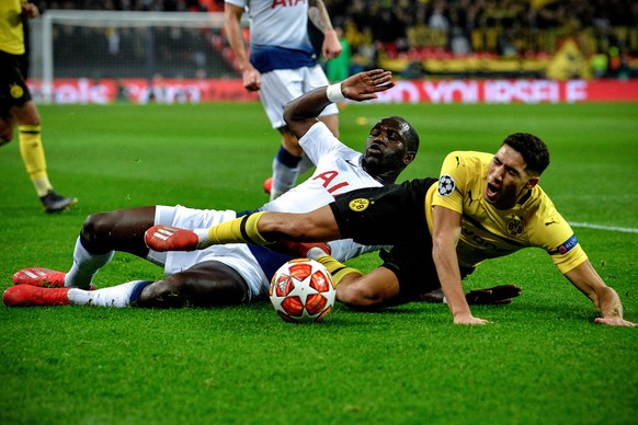 epa07367824 Tottenham's Serge Aurier (rear) in action against Dortmund's Achraf Hakimi (front) during the UEFA Champions League round of 16 soccer match between Tottenham Hotspur and Borussia Dortmund at Wembley Stadium, Britain, 13 February 2019.  EPA/NEIL HALL