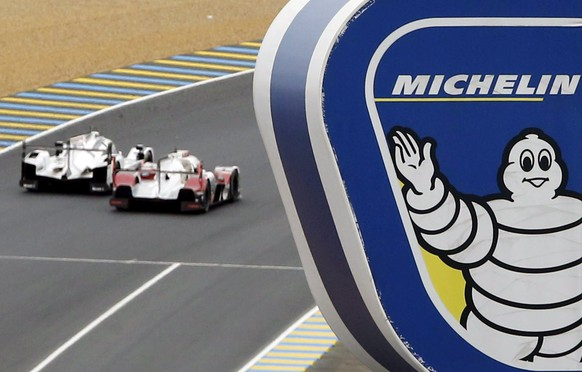Logo of French tyre manufacturer Michelin is seen near the track as drivers compete during the Le Mans 24 Hours sportscar race in Le Mans, June 14, 2015. REUTERS/Regis Duvignau
