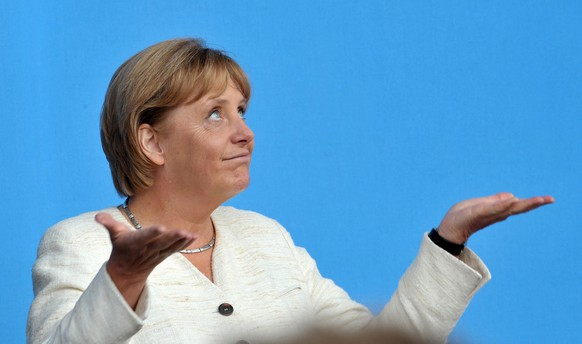 epa07207879 (FILE) - German Chancellor Angela Merkel and CDU (Germany's Christian Democrats) frontrunner in the upcoming Bundestag elections holds up her hands as it begins to rain during her speech at an election campaign event on Norderney island, Germany, 17 August 2009 (reissued 04 December 2018). A successor to Angela Merkel as chairwoman of her CDU party will be elected on 07 December 2018. Merkel said she will not run for re-election as CDU chairwoman nor for Chancellor nor for any other political office.  EPA/CARMEN JASPERSEN  ATTENTION: This Image is part of a PHOTO SET GERMANY OUT *** Local Caption *** 01826760