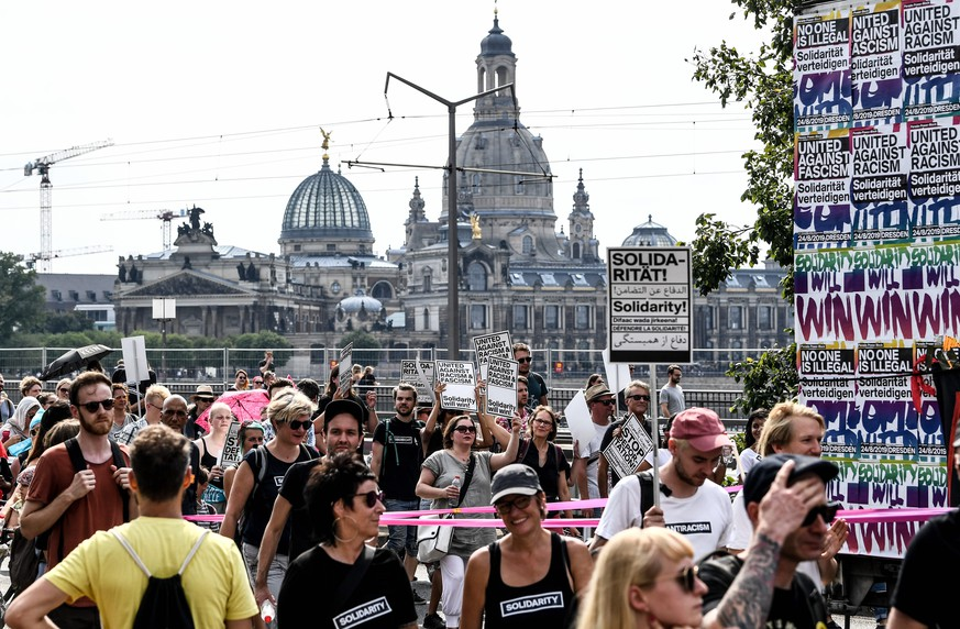 epa07790393 People attend a mass rally for an open society organized by action group 'Unteilbar' (indivisible) in Dresden, Germany, 24 August 2019. The rally calls for tolerance and diversity ahead of state elections in Saxony and Brandenburg, the eastern parts of Germany where the far-right has seen rising support in recent years.  EPA/FILIP SINGER
