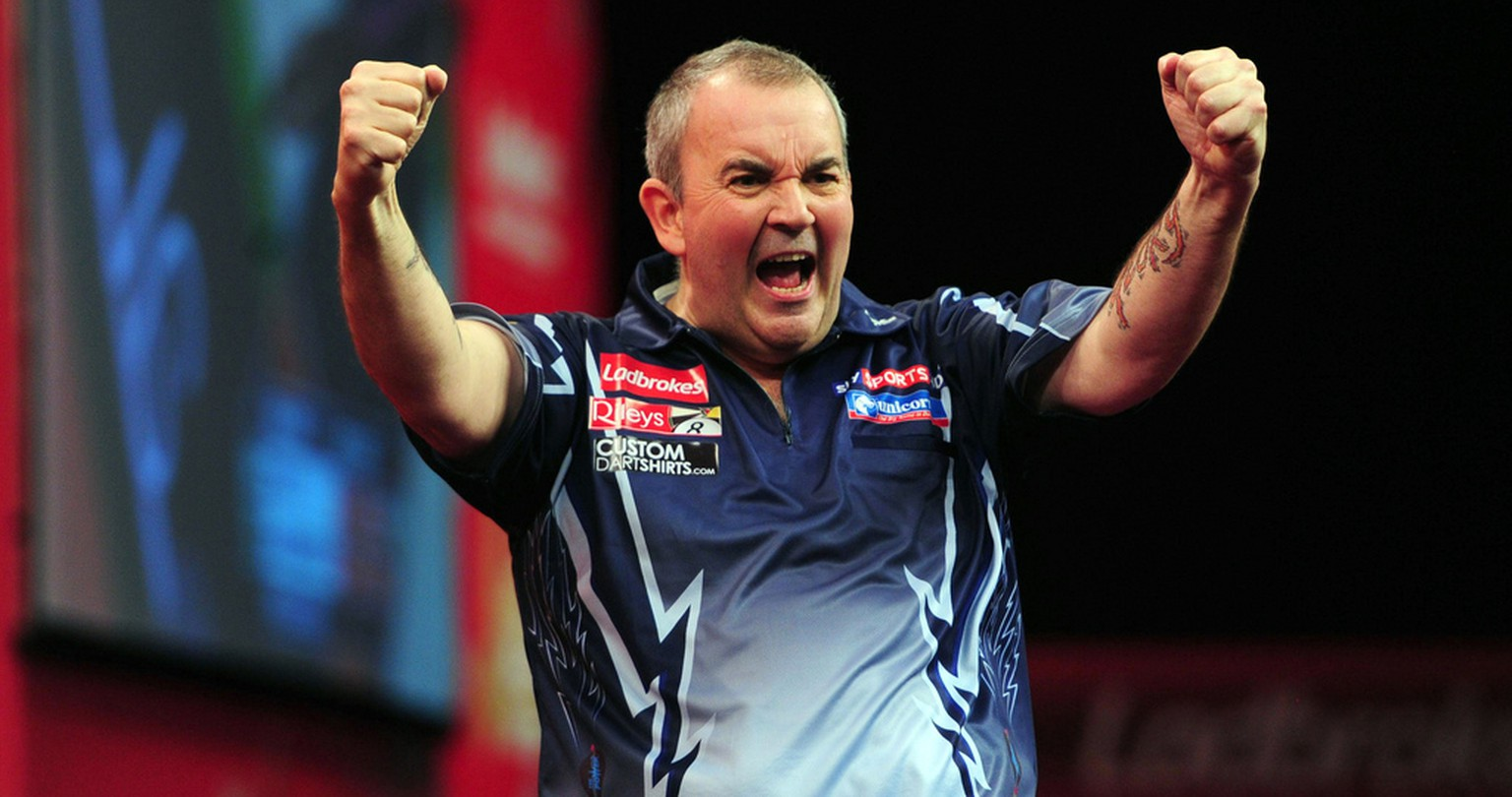 Britain's Phil Taylor celebrates defeating Raymond van Barneveld, of the Netherlands, in their semifinal match of  the Ladbrokes.com World Darts Championship at Alexandra Palace, in London, Sunday, Dec. 30, 2012. (AP Photo/PA) UNITED KINGDOM OUT NO SALES NO ARCHIVE