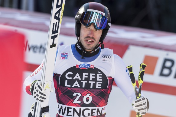 Gilles Roulin from Switzerland reacts in the finish area during the men's downhill race at the Alpine Skiing FIS Ski World Cup in Wengen, Switzerland, Saturday, January 13, 2018. (KEYSTONE/Peter Schneider)