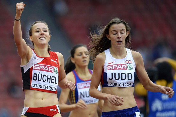 epa04351531 Selina Buechel (L) from Switzerland and Jessica Judd (R) from Britain react after competing in the women's 800m heat during the European Athletics Championships 2014 in the Letzigrund Stadium in Zurich, Switzerland, 13 August 2014.  EPA/STEFFEN SCHMIDT