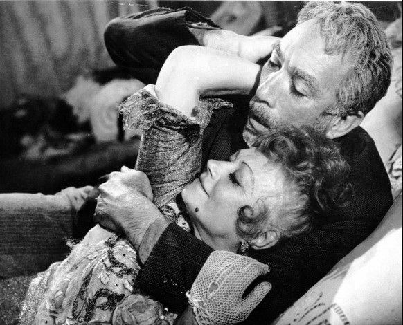 Anthony Quinn and Lila Kedrova are shown in a scene from