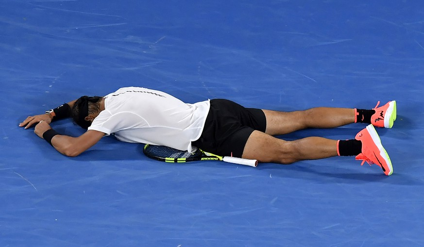 Spain's Rafael Nadal celebrates after defeating Bulgaria's Grigor Dimitrov during their semifinal at the Australian Open tennis championships in Melbourne, Australia, early Saturday, Jan. 28, 2017. (AP Photo/Andy Brownbill)