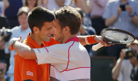 Stan Wawrinka of Switzerland (R) hugs Novak Djokovic of Serbia after winning their men's final match at the French Open tennis tournament at the Roland Garros stadium in Paris, France, June 7, 2015.                  REUTERS/Vincent Kessler TPX IMAGES OF THE DAY