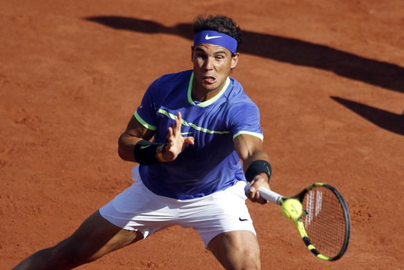Spain's Rafael Nadal hits a forehand to Austria's Dominic Thiem during their semifinal match of the French Open tennis tournament at the Roland Garros stadium, in Paris, France, Friday, June 9, 2017. (AP Photo/Petr David Josek)