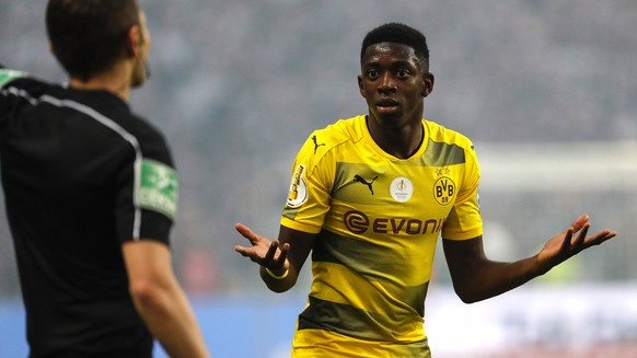 epa05994121 Dortmund's Ousmane Dembele reacts during the German DFBCup final soccer match between Eintracht Frankfurt and Borussia Dortmund at the Olympic Stadium in Berlin, Germany, 27 May 2017.  (ATTENTION: The DFB prohibits the utilisation and publication of sequential pictures on the internet and other online media during the match (including half-time). ATTENTION: BLOCKING PERIOD! The DFB permits the further utilisation and publication of the pictures for mobile services (especially MMS) and for DVB-H and DMB only after the end of the match.)  EPA/FELIPE TRUEBA