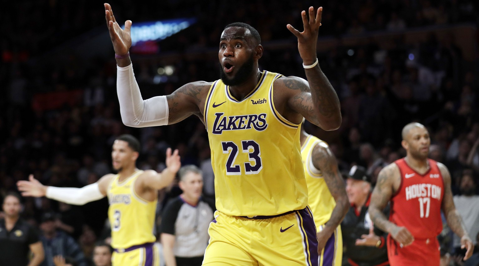 Los Angeles Lakers' LeBron James (23) reacts to a foul called against him during the second half of the team's NBA basketball game against the Houston Rockets on Thursday, Feb. 21, 2019, in Los Angeles. (AP Photo/Marcio Jose Sanchez)