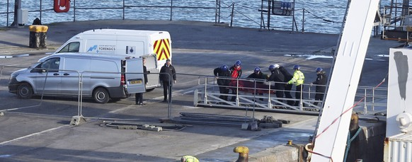 A stretcher carrying a body is removed from the Geo Ocean III specialist search vessel docked in Portland, England, Thursday Feb. 7, 2019.  A body has been recovered from the wreckage of the plane carrying Cardiff City footballer Emiliano Sala and pilot David Ibbotson, though the aircraft remains 67 metres underwater 21 miles off the coast of Guernsey in the English Channel after poor weather halted recovery efforts. (Steve Parsons/PA via AP)
