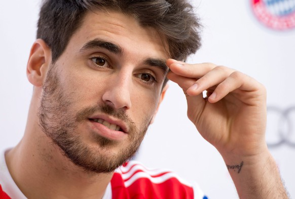 epa04558160 Munich's player Javi Martinez is seen during a press conference in Doha, Qatar, 13 January 2015. Bayern Munich stays in Qatar until 17 January 2015 to prepare for the second half of the German Bundesliga season.  EPA/SVEN HOPPE