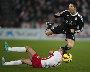 Real Madrid's Cristiano Ronaldo from Portugal, right, in action with Almeria's Francisco Velez during a Spanish La Liga soccer match at the Juegos Mediterraneos stadium in Almeria, southeast Spain, Friday, Dec. 12, 2014. (AP Photo/Daniel Tejedor)