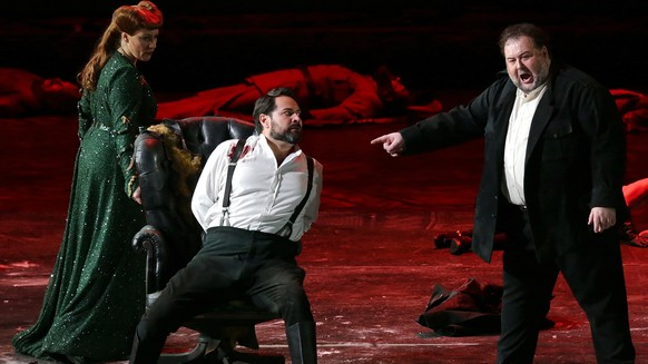 This undated photo made available by La Scala opera theater on Dec. 5, 2018 shows Spanish soprano Saioa Hernandez, left, and Russian bass Ildar Abdrazakov, center, and Italian soprano Fabio Sartori performing during a rehearsal of Giuseppe Verdi's