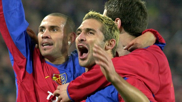 Basel's Christian Gimenez, left, reacts after he scores the second goal, with his teammates Julio Rossi, center, who scores first at the Champions League, Group B, soccer game Basel vs Liverpool in Basel, Switzerland, Tuesday, November 12, 2002.(KEYSTONE/Eddy Risch)