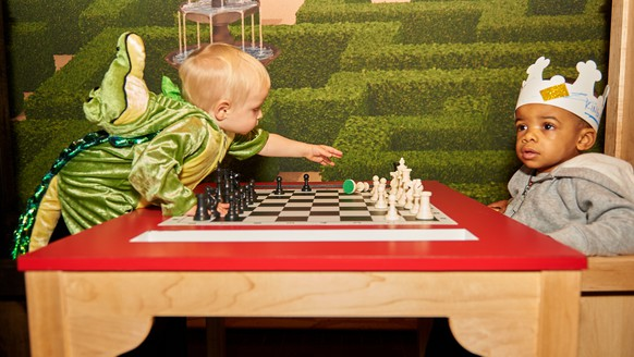 IMAGE DISTRIBUTED FOR WORLD CHESS HALL OF FAME - Children play in a chess exhibit at Kings, Queens & Castles, an interactive exhibition for children at the World Chess Hall of Fame on Saturday, Oct. 31, 2015 in St. Louis. (Photo by Michael Thomas/Invision for World Chess Hall of Fame/AP Images)